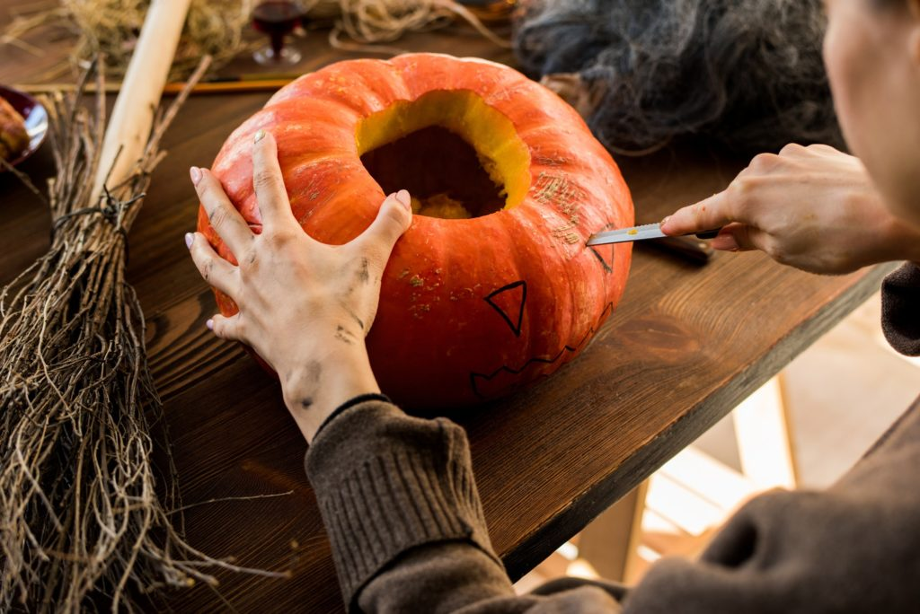 Carving pumpkin in workshop